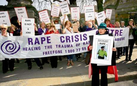 Maura Lane from Rathmines, Dublin, in front of a group of protesters outside the Dáil at a protest organised by the National Women's Council of Ireland against the trivialisation of rape