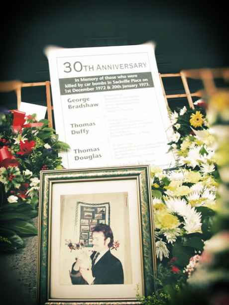 A closeup of the wreaths and momento at the 30th anniversary